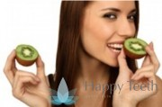 Lady eating kiwi fruit