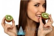 Lady eating kiwi fruit